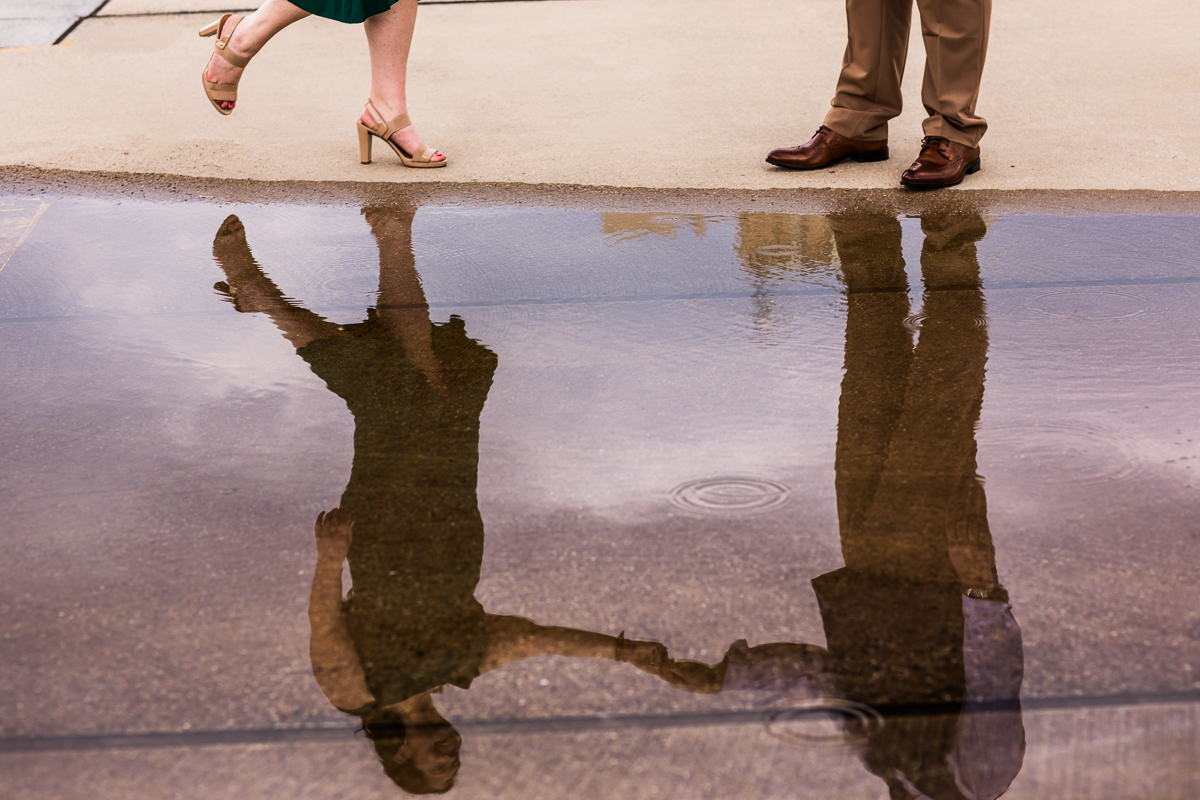couples reflection in water creative