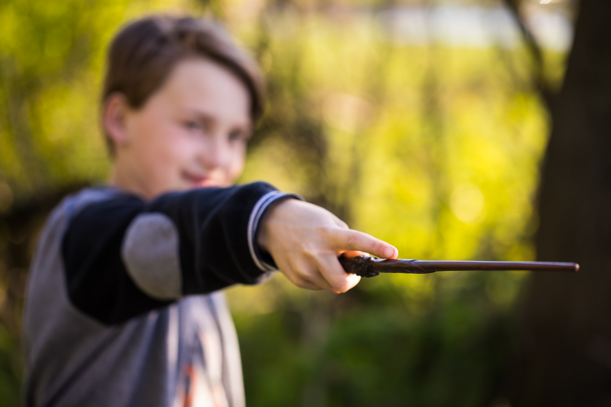 boy holding wand creative depth of field Harry Potter session