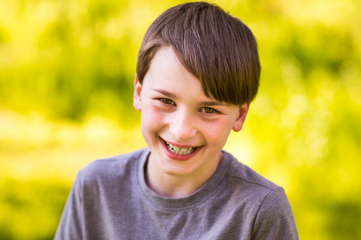 boy smiling at camera for portrait traditional authentic natural