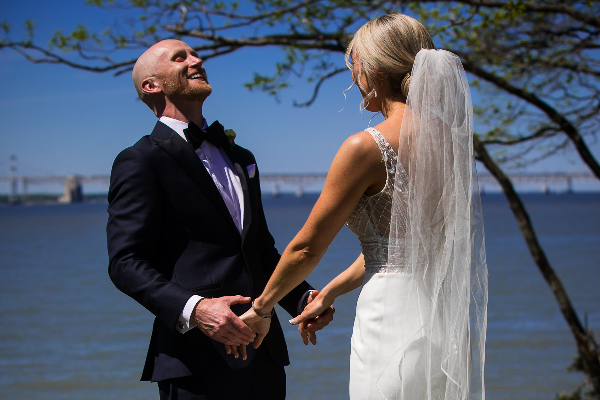 emotional waterfront first look with bride and groom at Chesapeake bay wedding in a stevensville maryland wedding