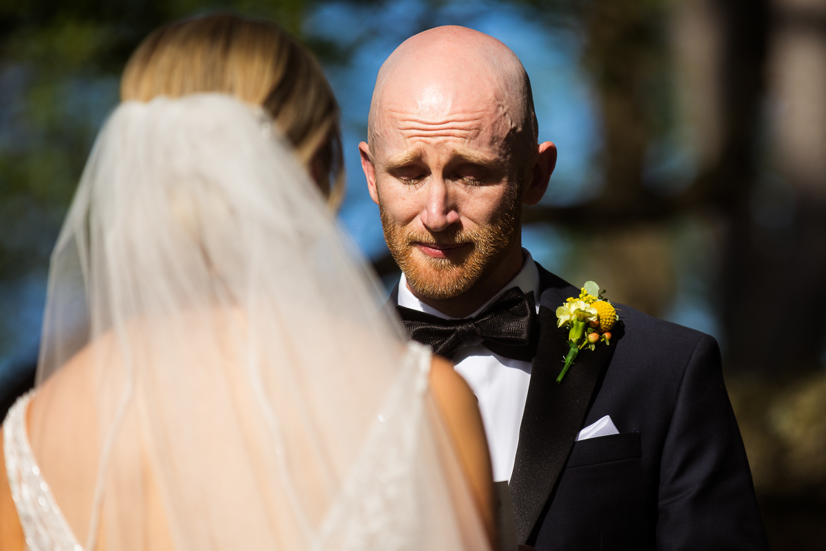emotional photo of groom crying during vow exchange