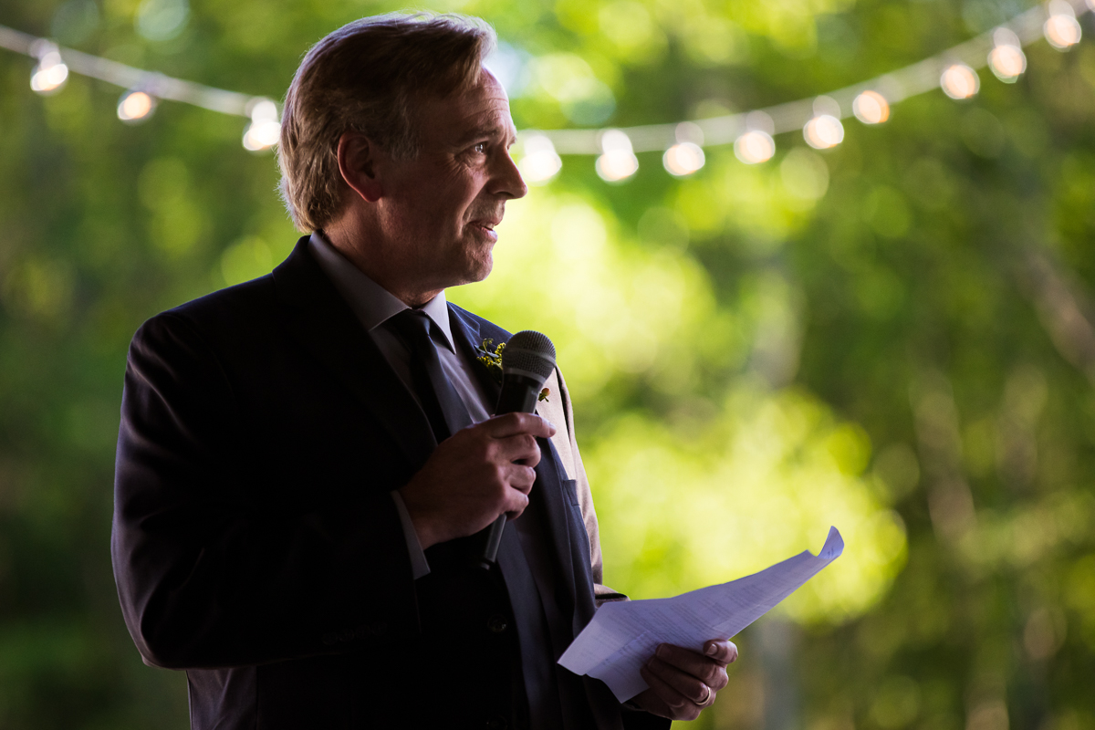 father of the bride giving speech during wedding reception outdoors best Maryland photographer
