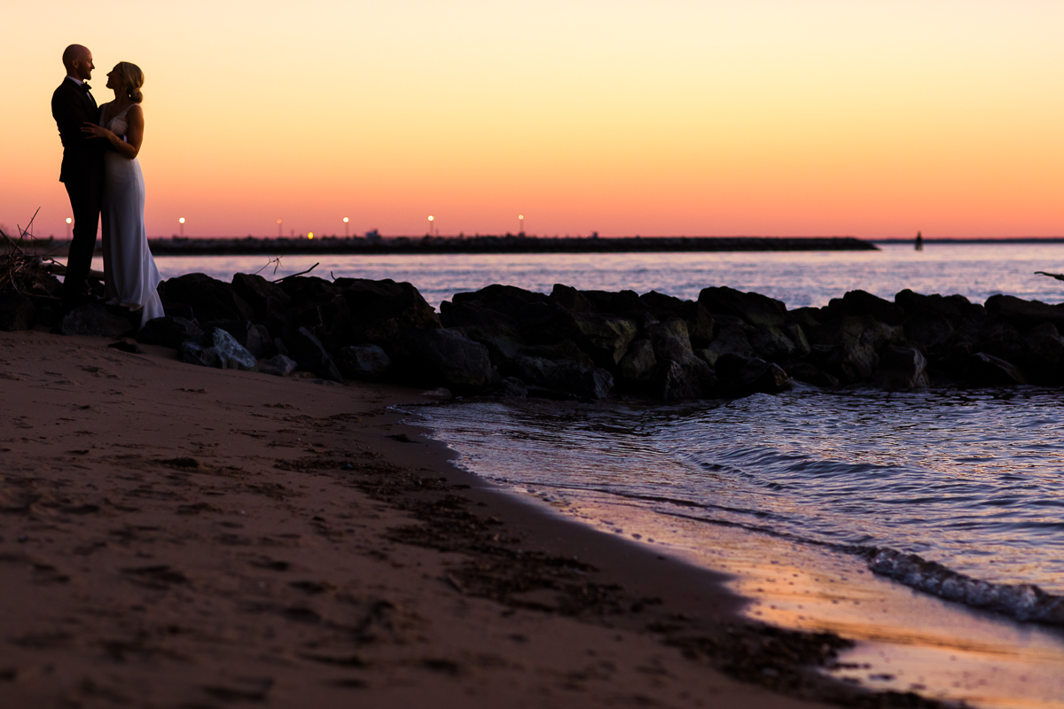 bride and groom during sunset at Chesapeake bay waterfront stevensville maryland wedding