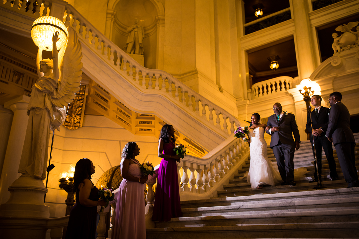 harrisburg-capitol-rotunda-wedding-photographer father walking bride down steps unique architecture intimate ceremony greek statues