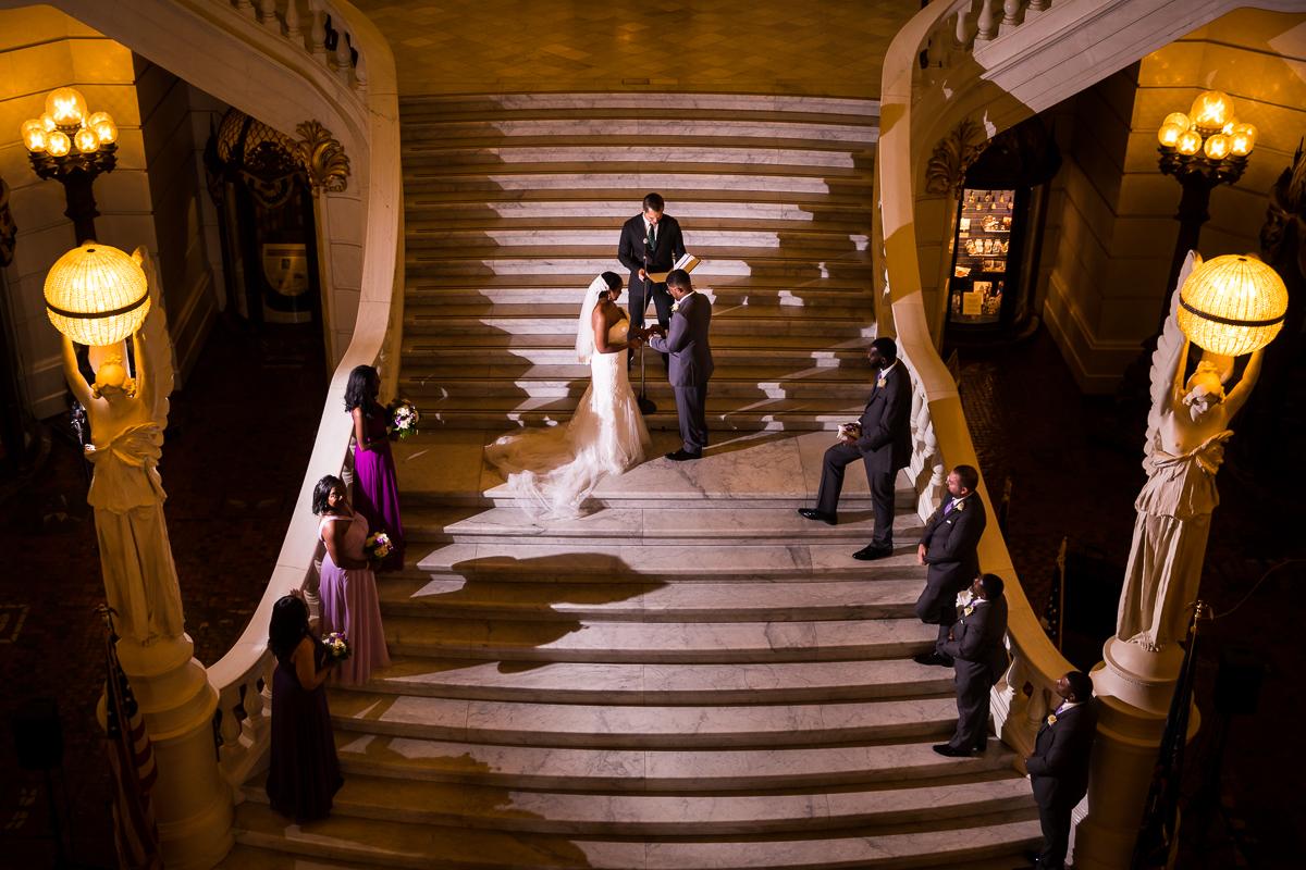 harrisburg-capitol-rotunda-wedding-photographer unique perspective creative fun non traditional wedding photo of steps inside Harrisburg capitol complex