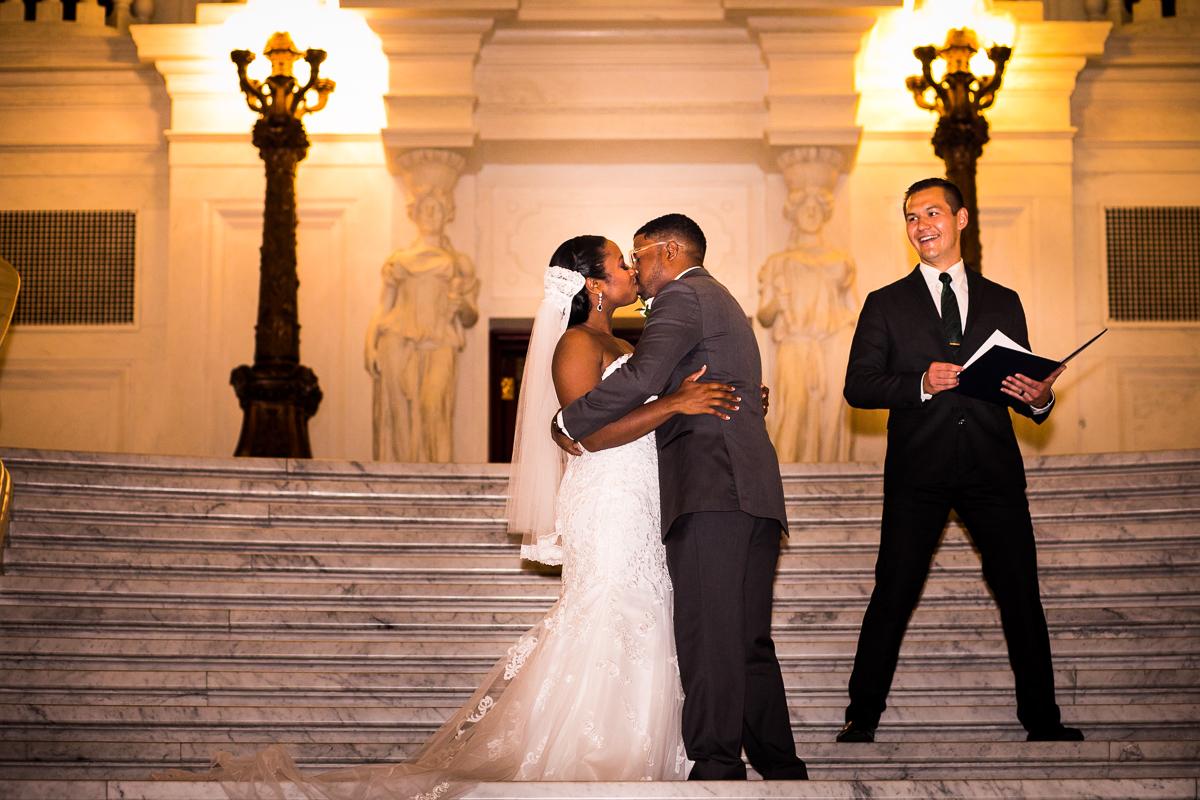 harrisburg-capitol-rotunda-wedding-first kiss on steps best central pa wedding photographer downtown Harrisburg capitol complex