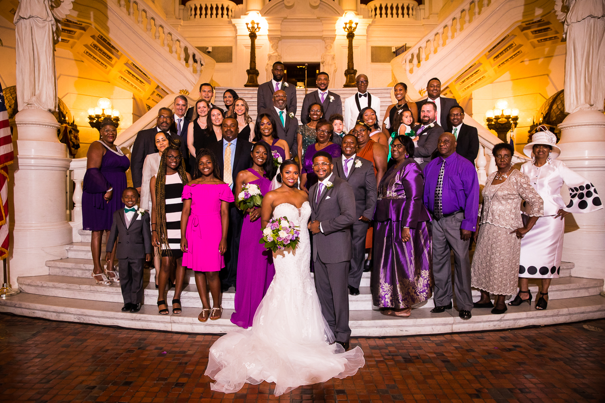 best harrisburg-capitol-rotunda-wedding-photographer family photo traditional smiling on the steps inside building