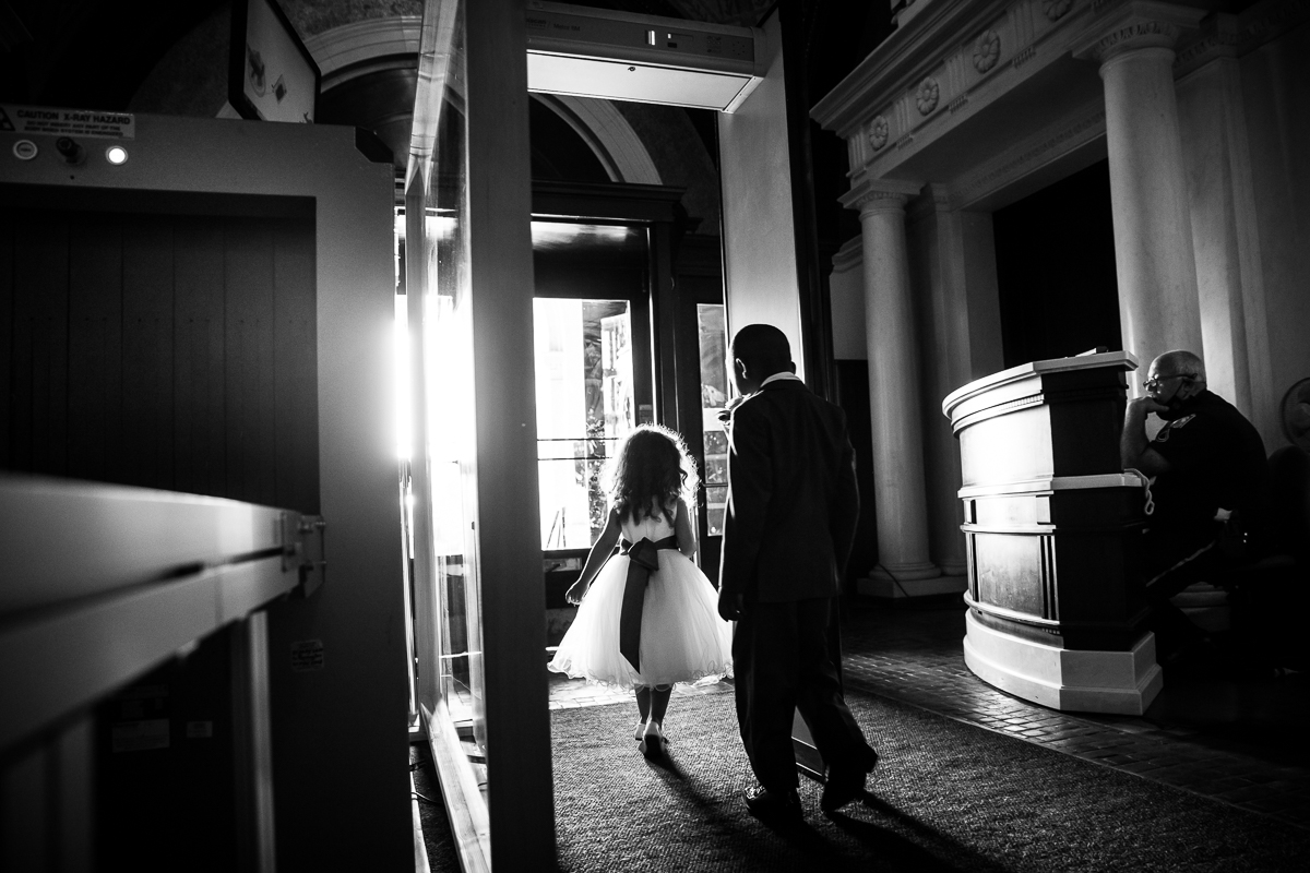 harrisburg-capitol-rotunda-wedding-security black and white photo of flower girl and ring bearer going through security
