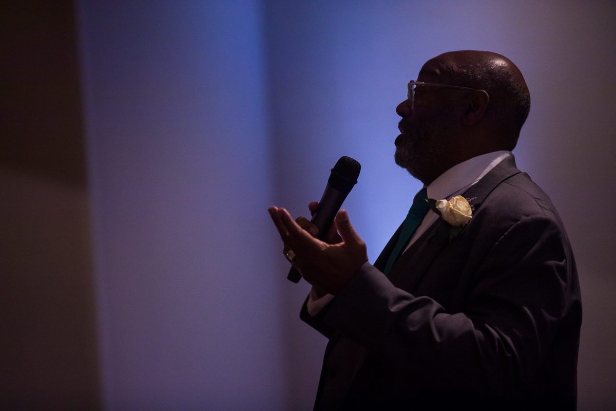 father of the groom giving speech during wedding reception at Hilton Harrisburg pennsylvania with purple uplighting