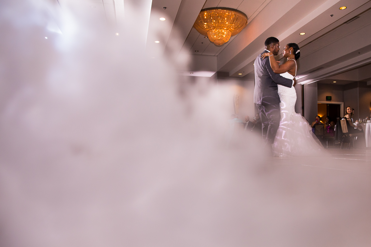 bride and groom dancing on cloud during first dance Hilton Harrisburg best creative unique pa wedding photographer