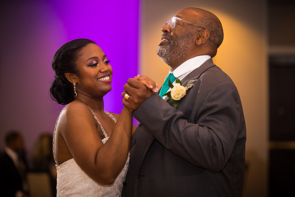 father and daughter dance during Hilton Harrisburg reception emotional artistic wedding photographer best central pa