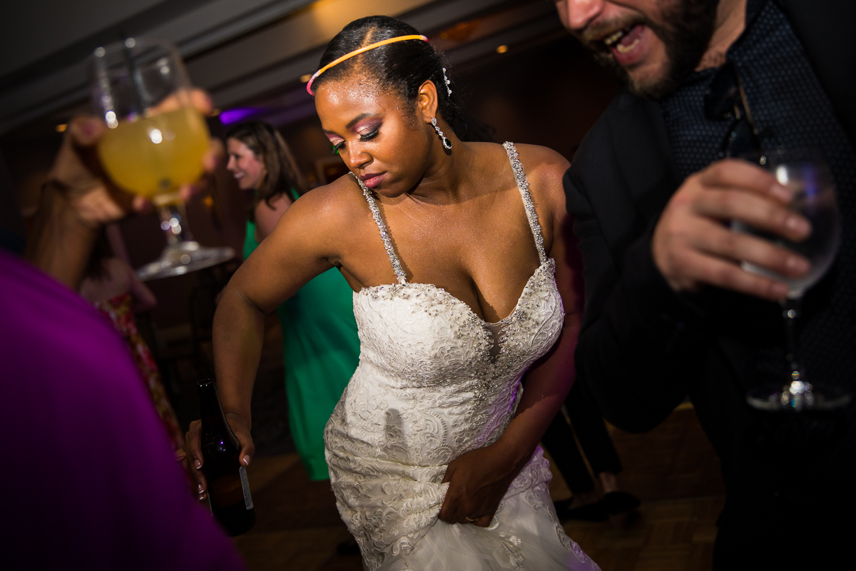 bride dancing during reception with glow stick ring on head best pa wedding photographer