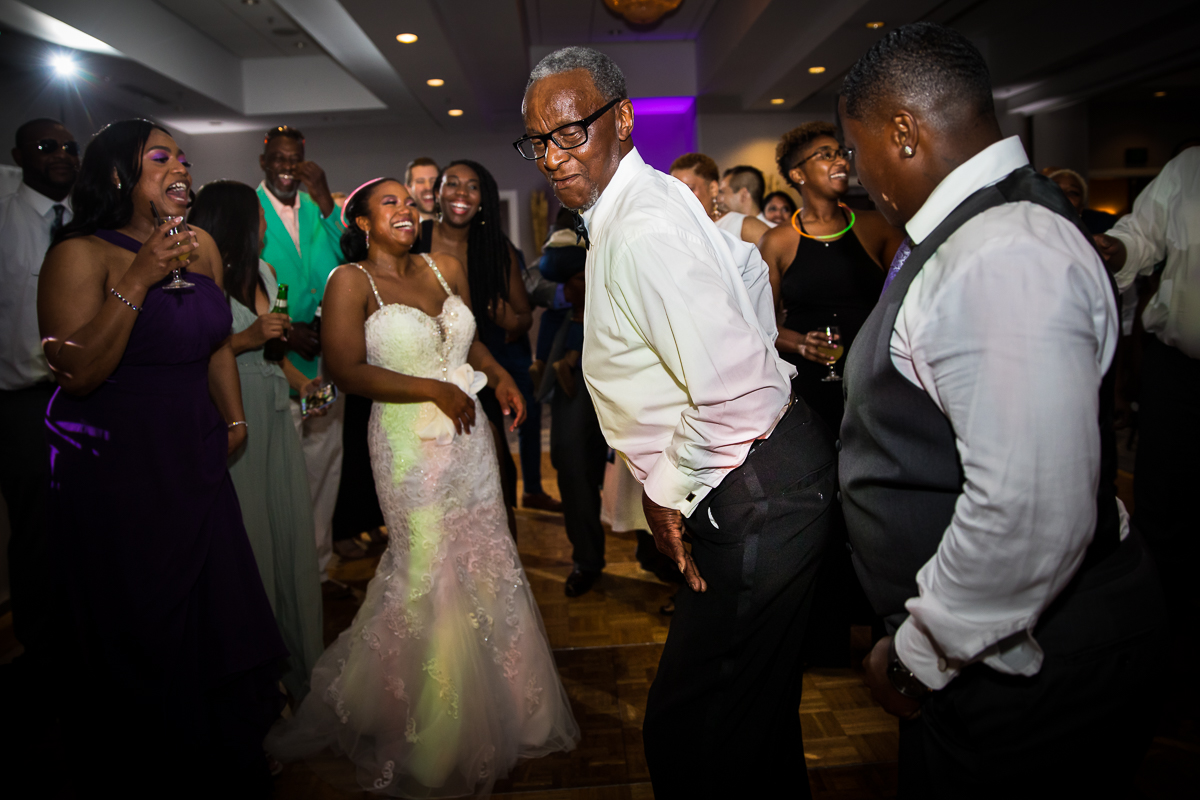 wedding guests showing off their dance skills during wedding reception in Harrisburg pennsylvania candid natural photographer