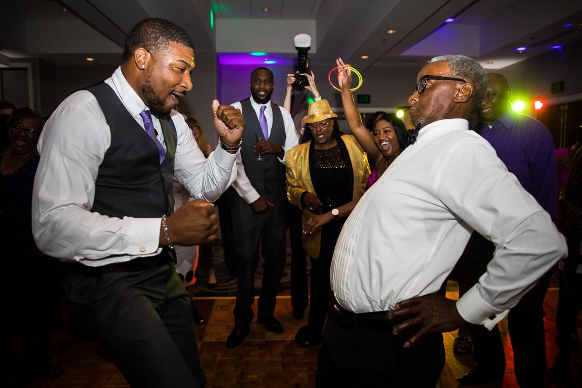 dance battle inside Hilton of Harrisburg pennsylvania wedding reception best award winning photographer