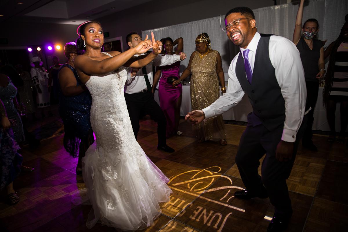 bride and groom dancing with fun uplighting at Hilton Harrisburg pa wedding reception