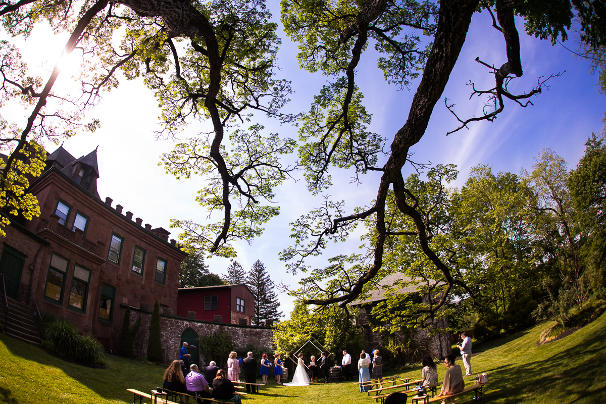 outdoor intimate wedding ceremony bride and groom saying vows mount hope estate and winery Manheim pennsylvania wide angle photo
