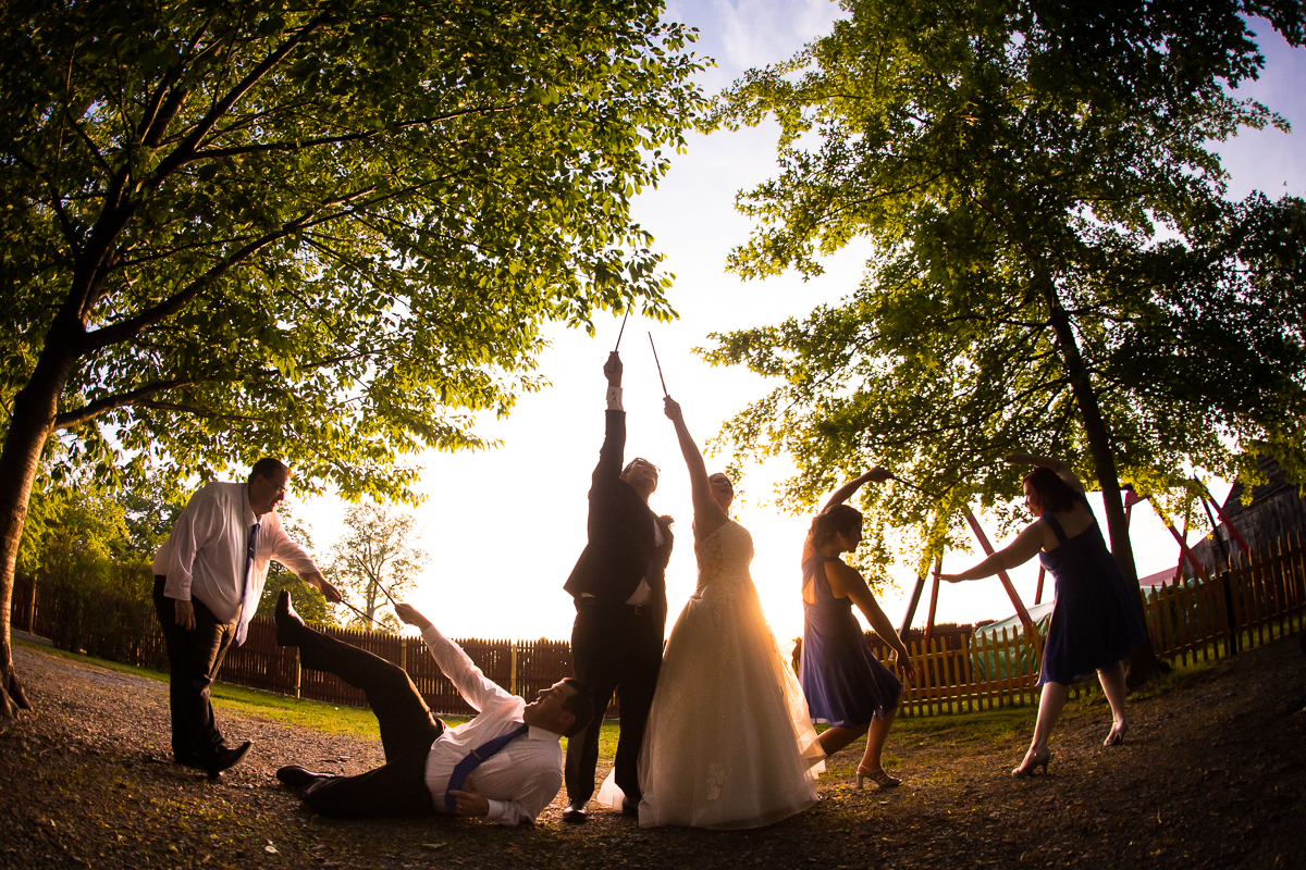 fun Harry Potter inspired wedding party photo with wands outside patronus