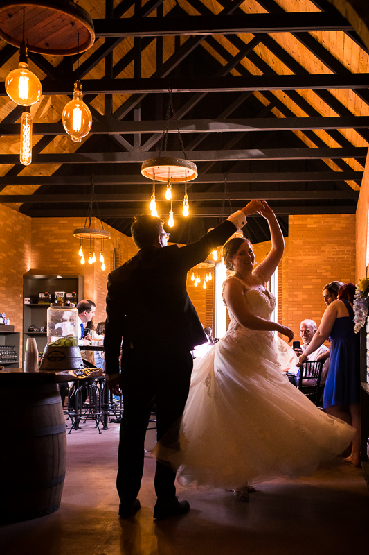 bride being twirled by groom during dancing photo at mount hope wedding reception