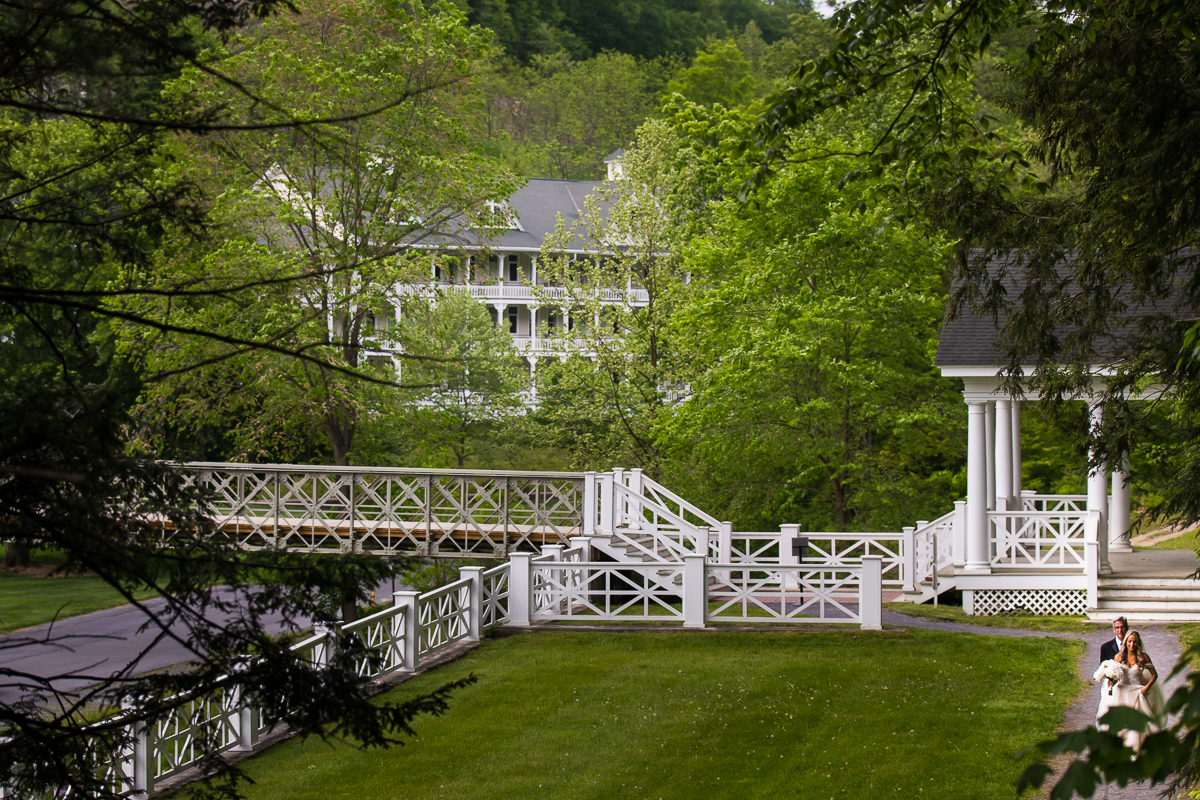 bride walking to first look outside omni Bedford springs wedding grounds outside wide angle perspective
