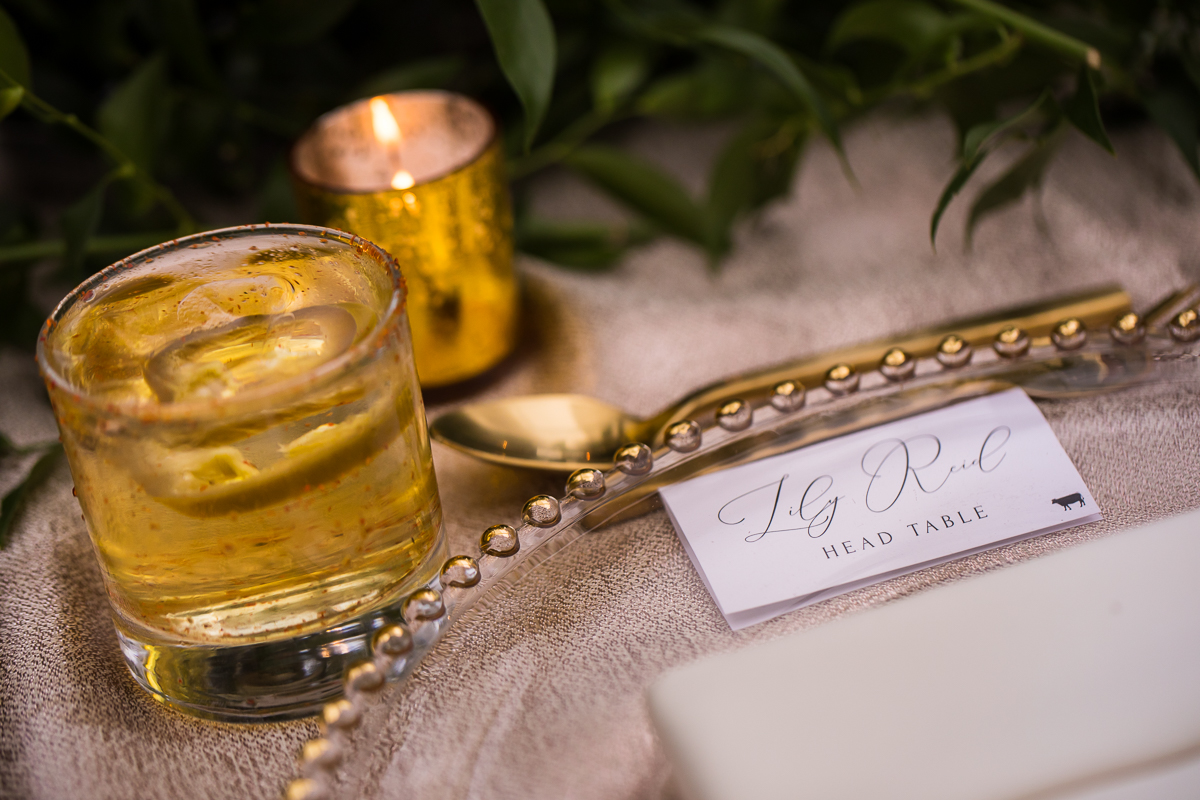 head table place setting with tea light candle and drink