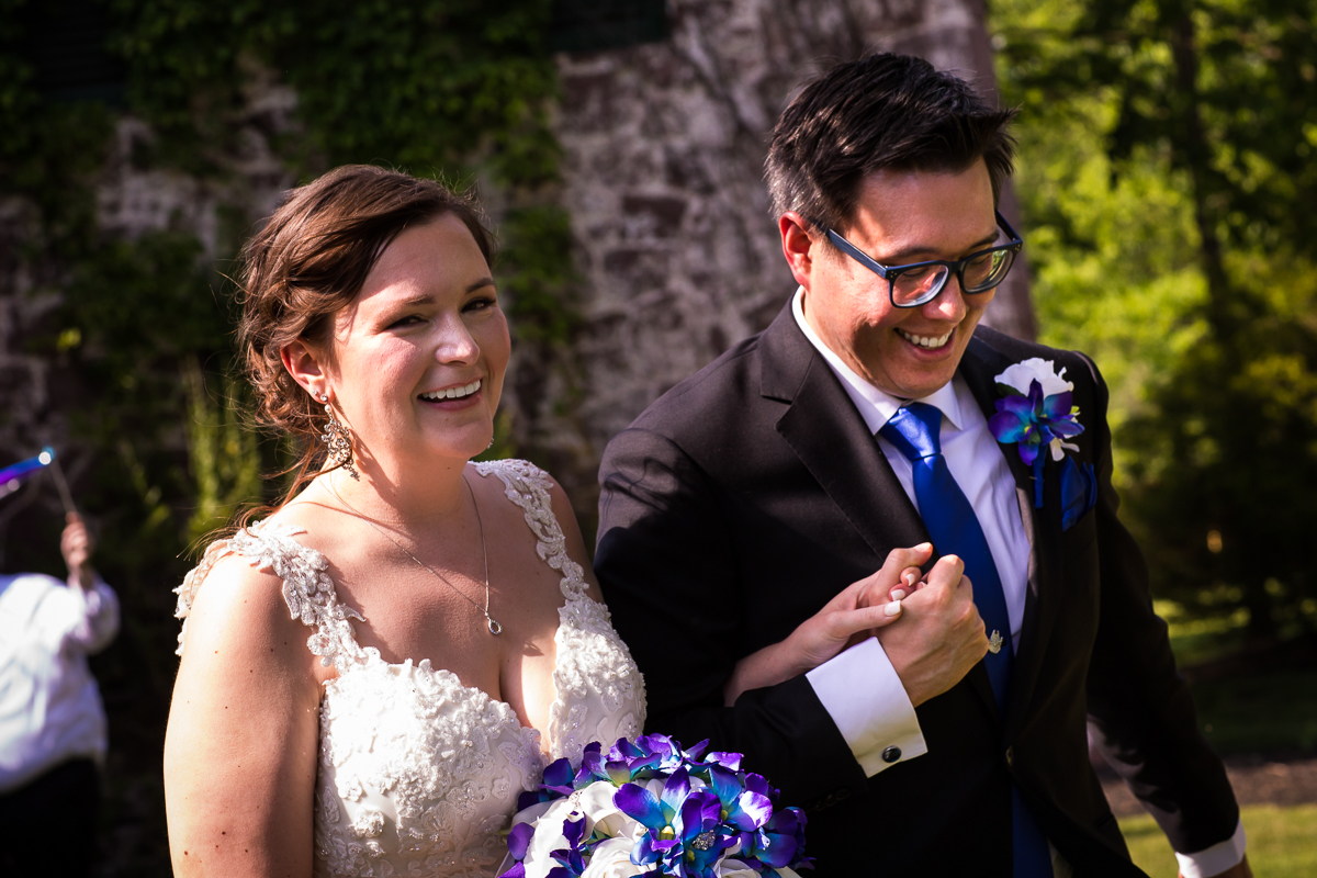mount hope estate wedding photographer photo showing bride and groom's wedding recessional