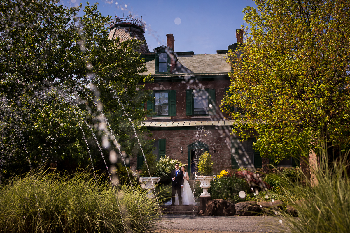 mount hope estate wedding photographer creative best award winning fountain photograph with mansion and bride and groom
