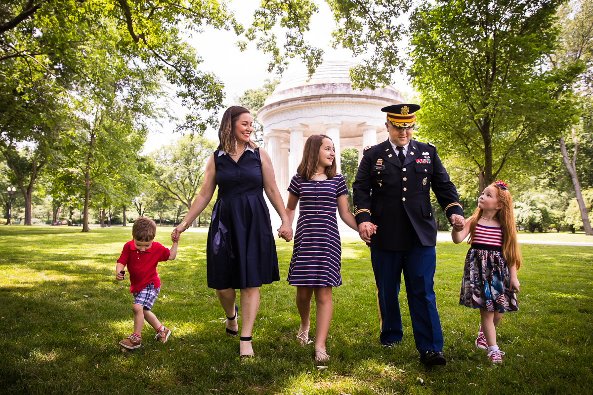 family holding hands walking after DC military promotion ceremony dressed in red white and blue best natural candid DC family photographer