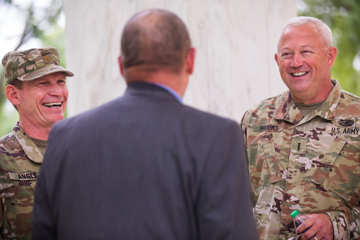 army men wearing camouflage uniform before DC military promotion ceremony begins