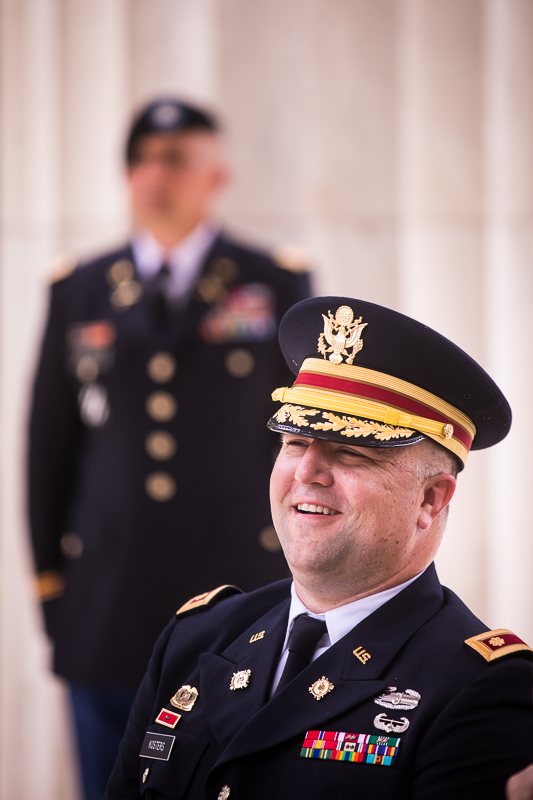 man wearing army uniform promoted to colonel smiling with army officer in background