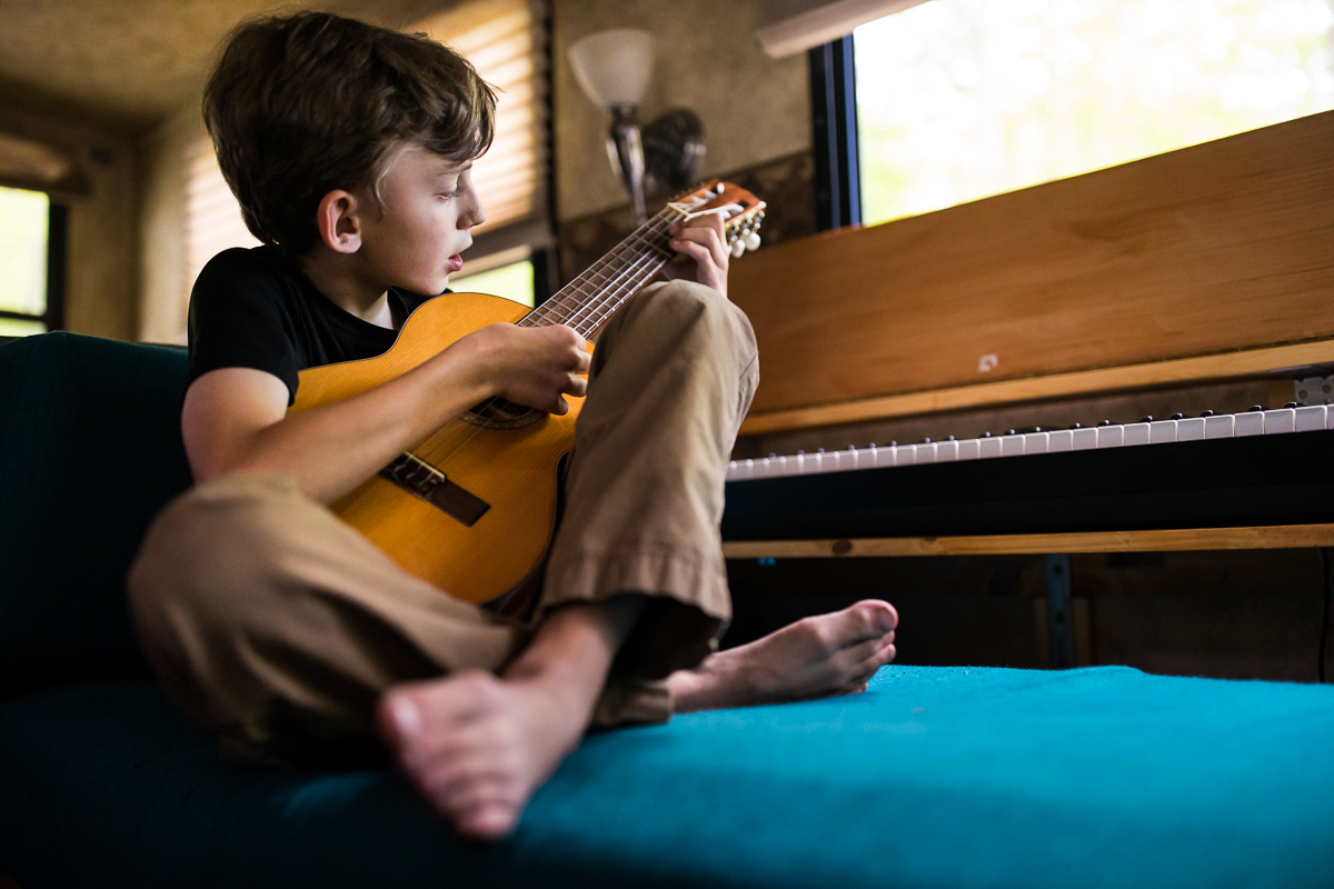 custom build rv with piano and guitar rv lifestyle best candid pennsylvania family photographer