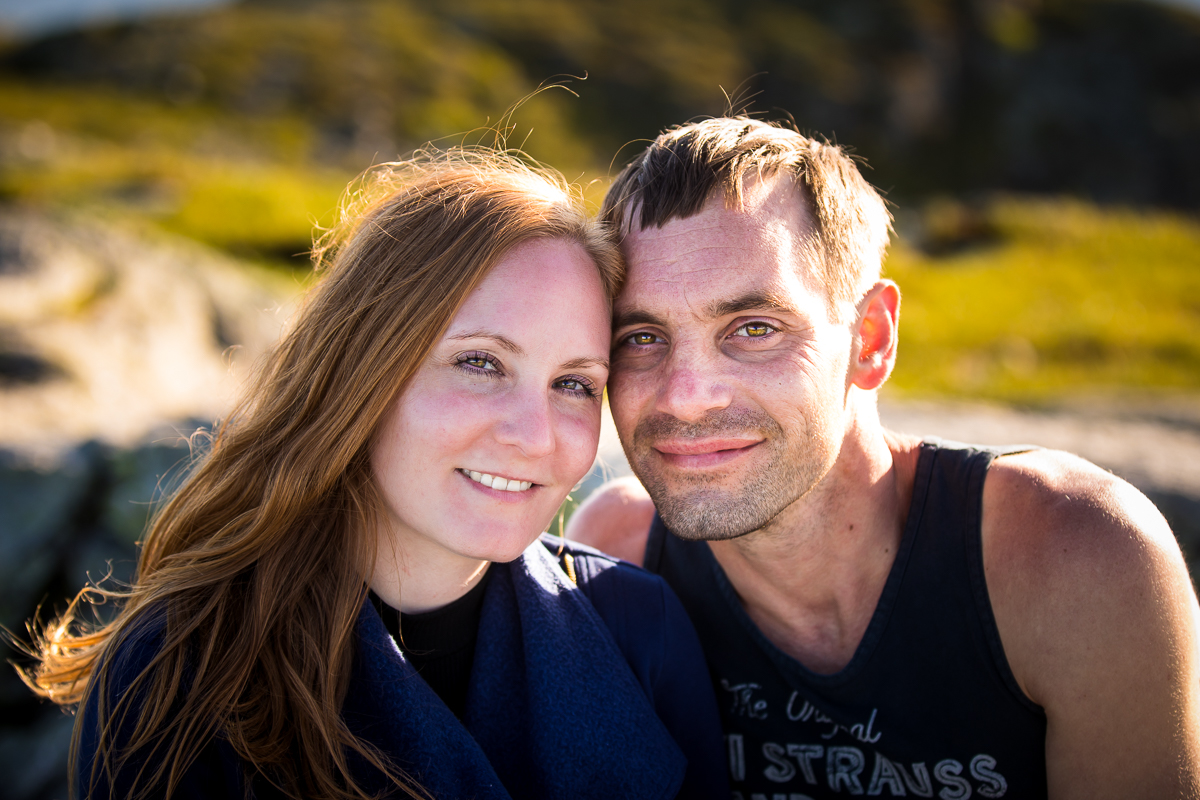 traditional portrait of couple smiling and looking at camera from top of mountain in vermont traditional portrait photographer central pa