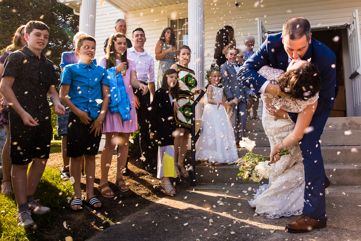 lavender and rose confetti exit after wedding ceremony guests throwing confetti fun unique creative central pa wedding photographer bell mountain estates wedding