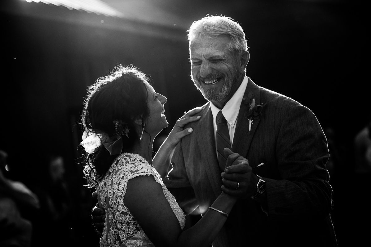 black and white photo of father daughter dancing together during wedding reception
