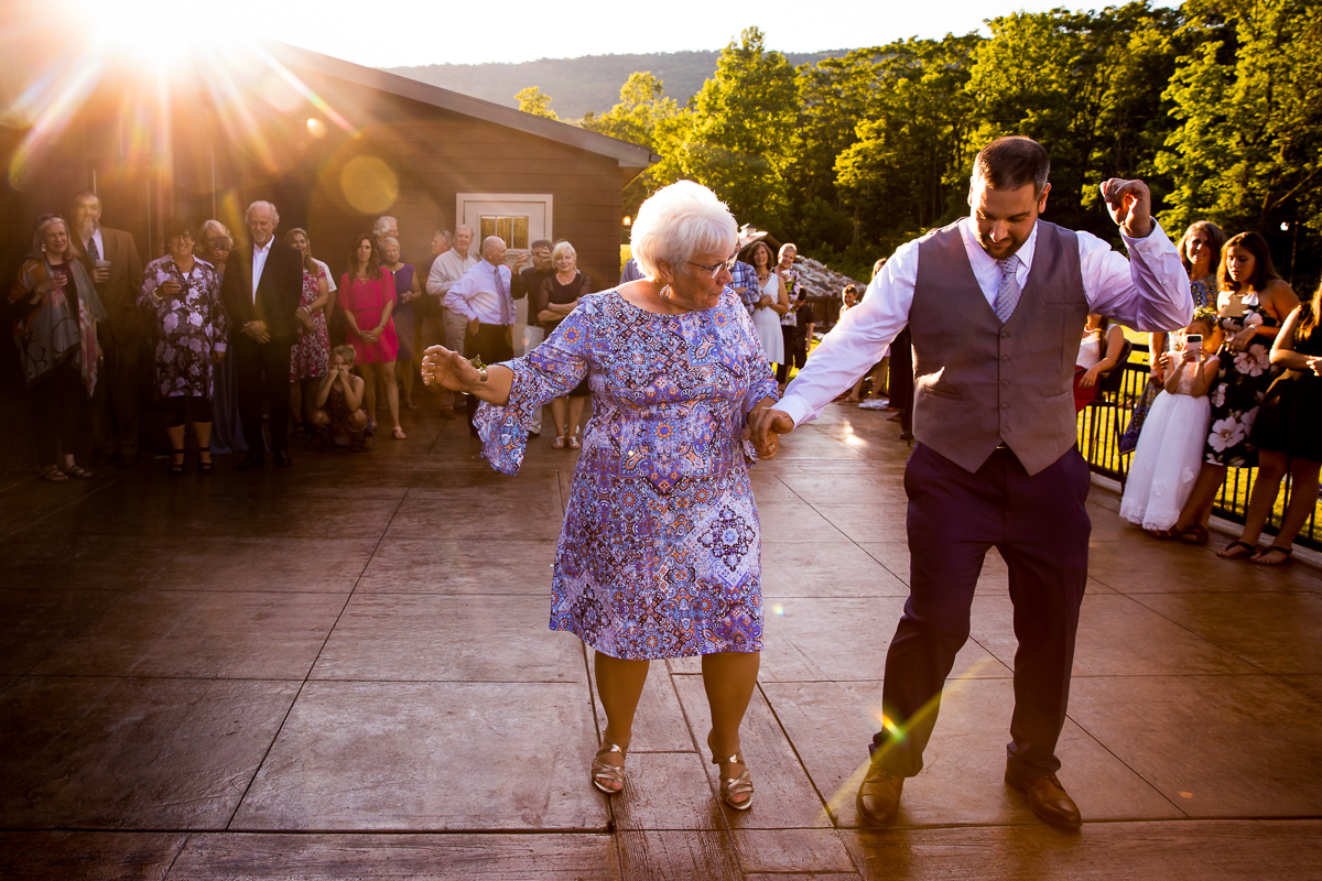 surprise fun dance for mother and son during wedding reception at bell mountain estates wedding