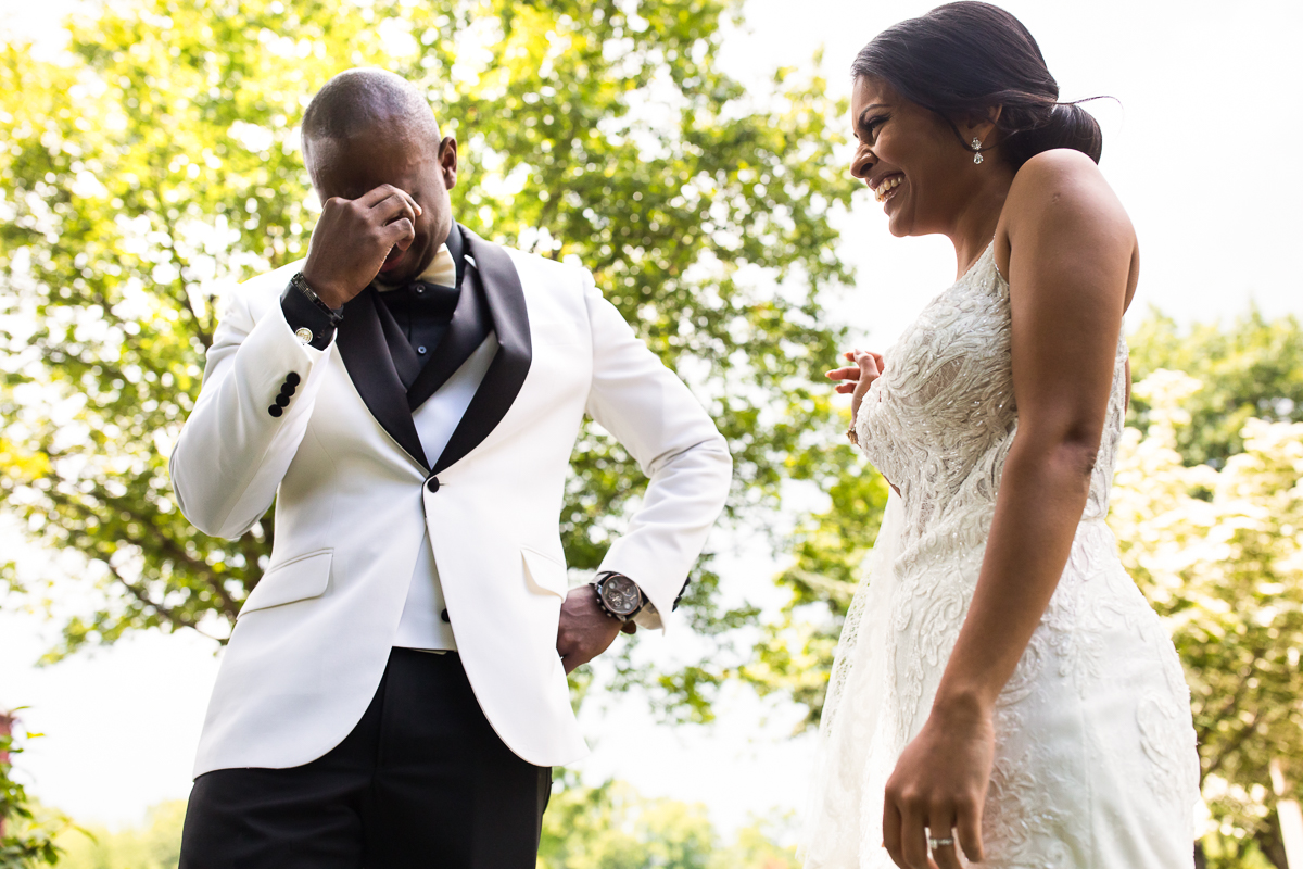 best first look groom crying after seeing bride during first look while bride smiles candid emotional photographer best award winning central PA