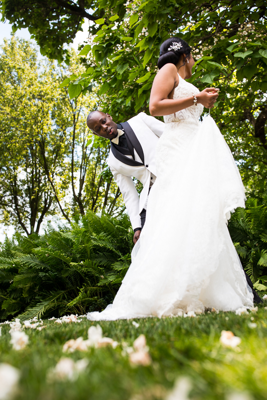 groom checking out bride in her wedding dress during first look authentic candid natural fun moment best farm at eagles ridge wedding photographer