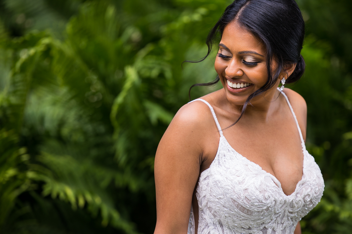 bride smiling looking back during wedding portraits candid photo