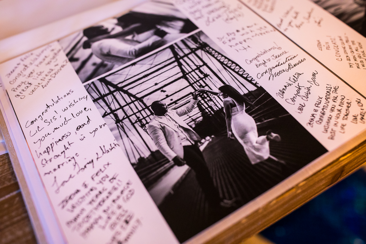 custom guest book designed by photographer with signatures surrounding photos during wedding reception
