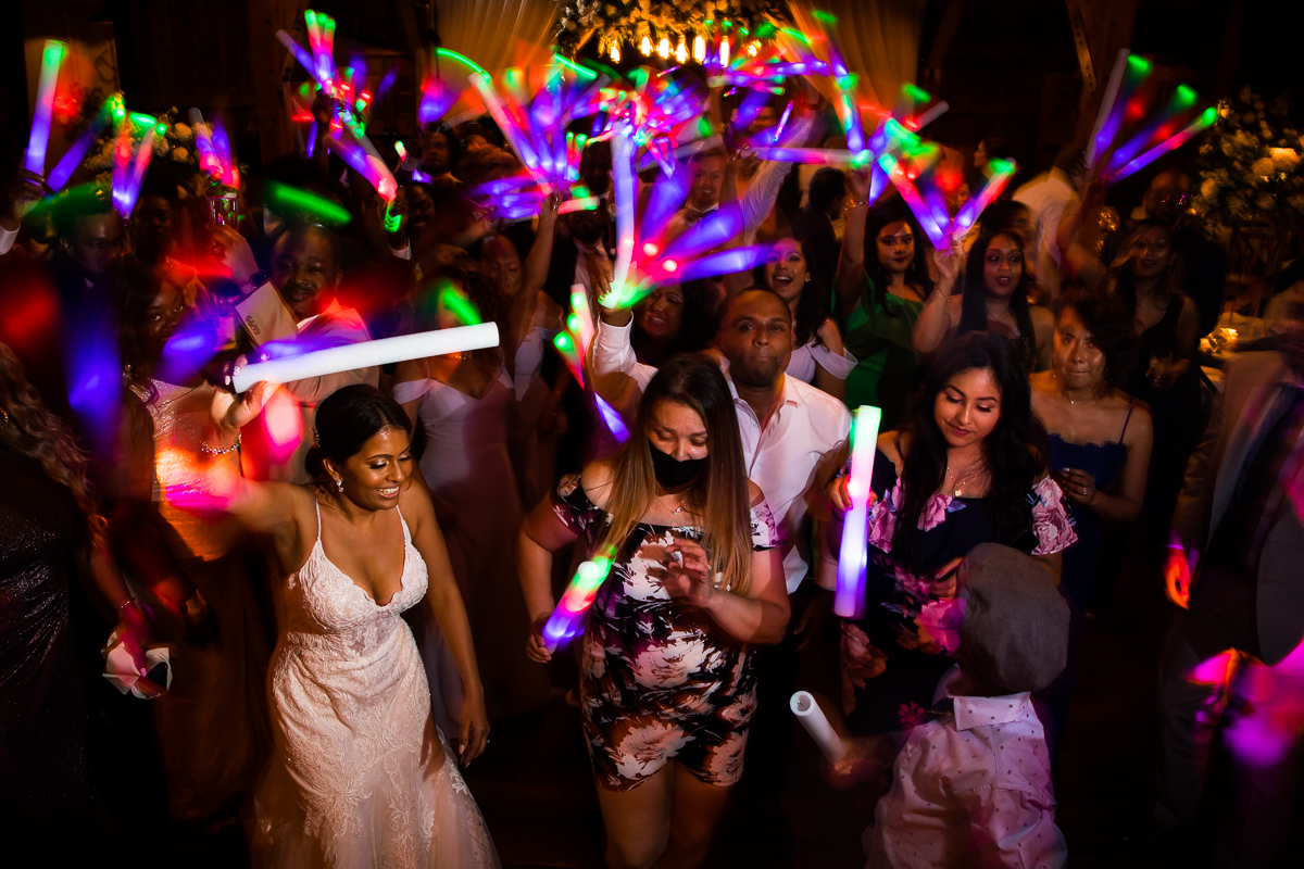 creative Lancaster wedding photographer wedding guests dance with glow sticks during reception candid wedding photographer best central pa farm at eagles ridge